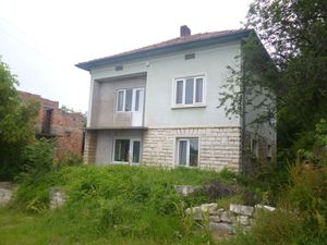 Big rural property with two houses & plot of land in village