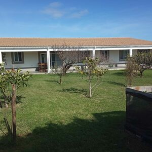 Property with 2 houses, 3 bungalows and 1 garage